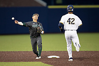 Michigan State Spartans second baseman Royce Ando (13) turns a double play as Michigan Wolverines baserunner Jordan Nwogu (42) arrives during the NCAA baseball game on May 7, 2019 at Ray Fisher Stadium in Ann Arbor, Michigan. Michigan defeated Michigan State 7-0. (Andrew Woolley/Four Seam Images)