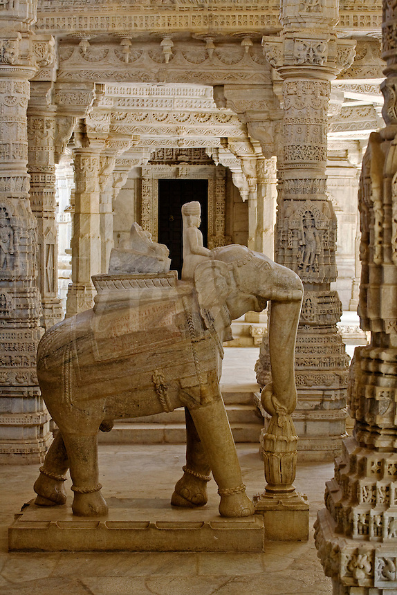 Carved white marble ELEPAHANT and RAJPUT inside the CHAUMUKHA MANDIR TEMPLE at RANAKPUR in the Pali District of RAJASTHAN near Sadri - INDIA