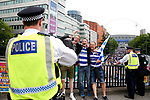 A policeman takes a photo for a group of Reading fans before the SkyBet Championship Play Off Final match at the Wembley Stadium, England. Picture date: May 29th, 2017.Picture credit should read: Matt McNulty/Sportimage