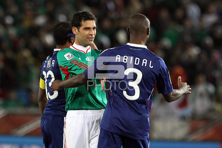 Rafael Marquez of Mexico argues with Eric Abidal of France