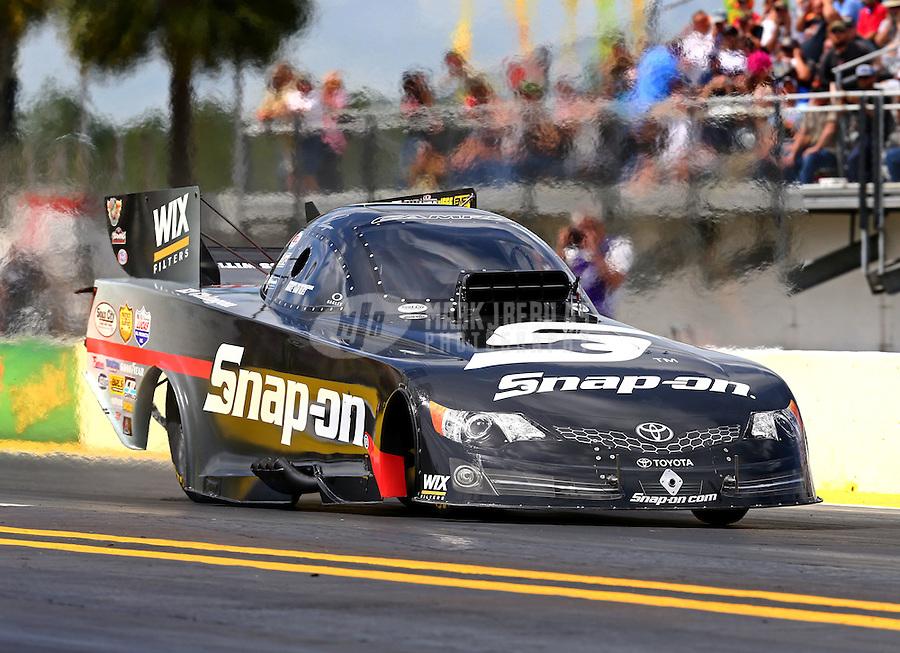Mar 13, 2015; Gainesville, FL, USA; NHRA funny car driver Cruz Pedregon during qualifying for the Gatornationals at Auto Plus Raceway at Gainesville. Mandatory Credit: Mark J. Rebilas-