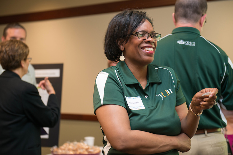 """Renea Morris, the Chief Marketing Officer for Univeristy Communications and Marketing, reads her """"fortune"""" from a fortune cookie from the Procurement Services table at the Campus Communicator Network Expo in Nelson Commons on Wednesday, May 11, 2016. © Ohio University / Photo by Kaitlin Owens"""