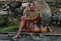 The very traditional Yapese during their festivities, the high Chief resting against the stone money, Yap a small island group between Guam and Palau