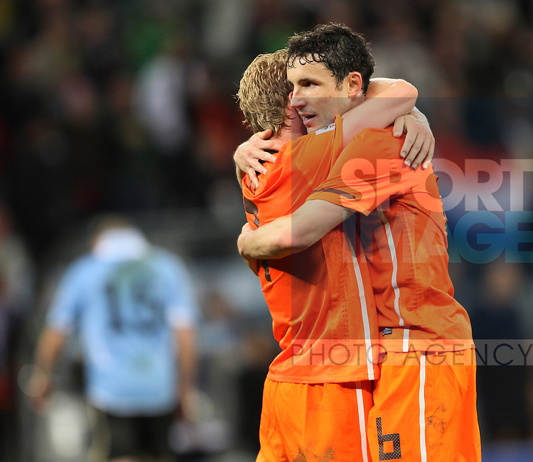 Netherland's Mark Van Bommel and Dirk Kuyt celebrate at the final whistle