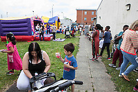 Children Playing at a bouncy castle during Queen Elizabeth II brthday celebrations at the Barking Community Centre in East London.