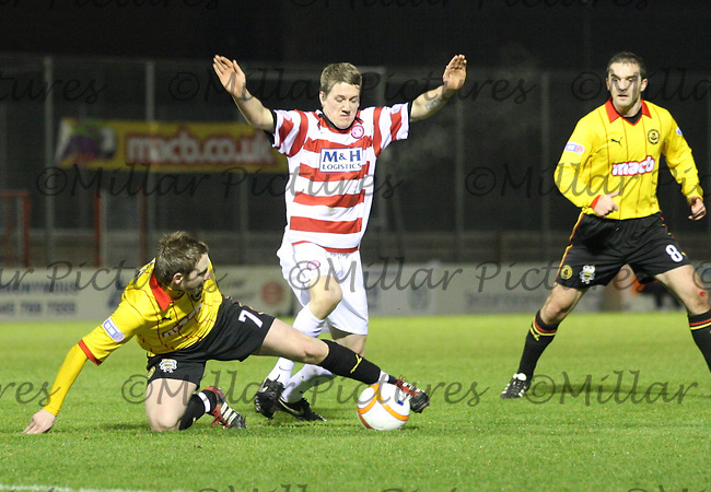 Paul Cairney wins the ball from Jim McAlister in the Hamilton Academical v Partick Thistle Irn-Bru Scottish League Division One match played at New Douglas Park, Hamilton on 13.1.12...