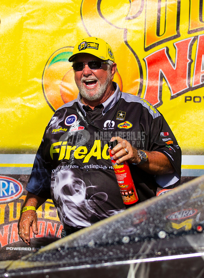 May 6, 2018; Commerce, GA, USA; NHRA top fuel driver Leah Pritchett (not pictured) celebrates with sponsor Ron Thames after winning the Southern Nationals at Atlanta Dragway. Mandatory Credit: Mark J. Rebilas-USA TODAY Sports