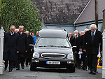 The funeral of Pádraig Faulkner leaves St Brigid's church Dunleer on it's was to Mosstown cemetery. Photo: Colin Bell/pressphotos.ie
