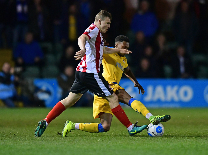 Lincoln City's Harry Anderson vies for possession with Chester's Kane Richards<br /> <br /> Photographer Chris Vaughan/CameraSport<br /> <br /> Vanarama National League - Lincoln City v Chester - Tuesday 11th April 2017 - Sincil Bank - Lincoln<br /> <br /> World Copyright &copy; 2017 CameraSport. All rights reserved. 43 Linden Ave. Countesthorpe. Leicester. England. LE8 5PG - Tel: +44 (0) 116 277 4147 - admin@camerasport.com - www.camerasport.com