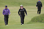Rory McIlroy and david Drysdale playing the 16th after play restarted on day 3 at the 3 Irish open in Co Louth Golf Club...Photo: Fran Caffrey/www.golffile.ie..