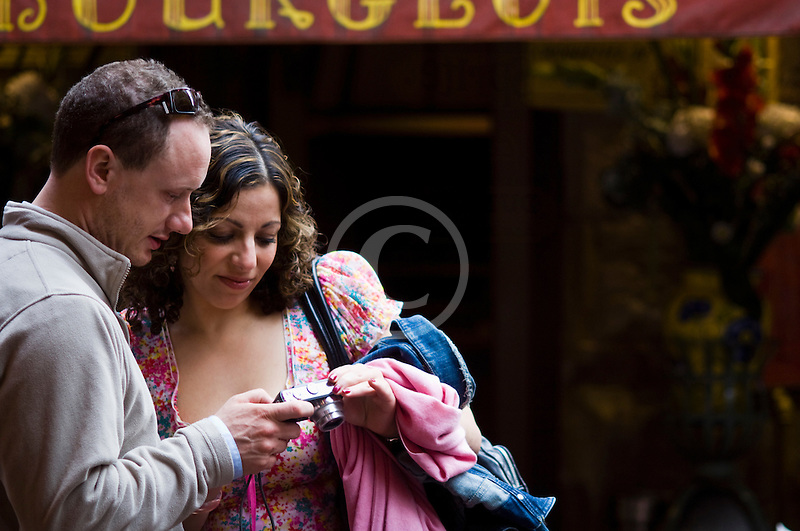 Belgium, Brussels, Romantic couple looking at photo