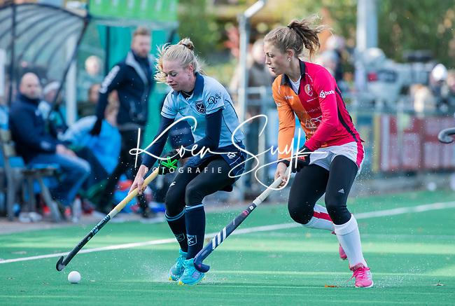 Laren - Josien Galama (Lar) met Laura Nunnink (OR)  tijdens de Livera hoofdklasse  hockeywedstrijd dames, Laren-Oranje Rood (1-3).  COPYRIGHT KOEN SUYK