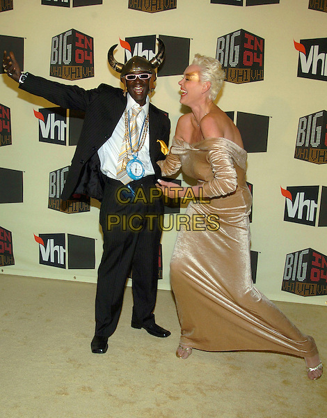 BRIGETTE NEILSON & FLAVOUR FLAV.VH1 Big in '04 held at the Shrine Auditorium, Los Angeles, California, 01 December 2004..full length funny.**UK SALES ONLY**.Ref: ADM.www.capitalpictures.com.sales@capitalpictures.com.©V.Summers/AdMedia/Capital Pictures .