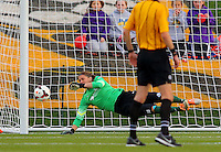BOYDS, MD - April 19 2014: Nicole Barnhart is beaten on a free kick from Christine Nairn for the Spirit third goal in Washington Spirit v FC Kansas City  NWSL match at Maryland Sportsplex, in Boyds, Maryland.<br /> Spirit won 3-1.