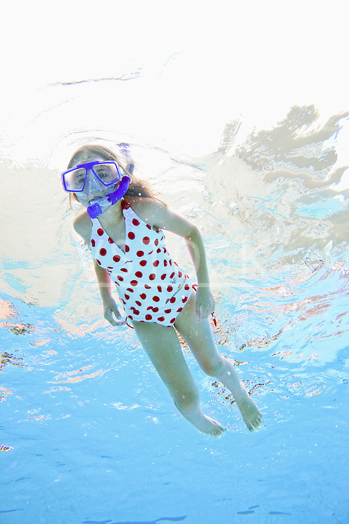 USA, Florida, St. Petersburg, Girl (10-11) diving in swimming pool
