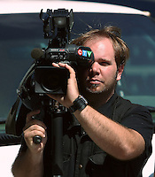 A CTV television network cameraman films a protest in Quebec city June 15, 2009.