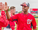 7 March 2015: Washington Nationals outfielder Michael Taylor gets high fives after Spring Training action against the St. Louis Cardinals at Space Coast Stadium in Viera, Florida. The Nationals rallied to defeat the Cardinals 6-5 in Grapefruit League play. Mandatory Credit: Ed Wolfstein Photo *** RAW (NEF) Image File Available ***