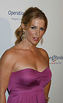 BEVERLY HILLS, CA. - October 02: Poppy Montgomery arrives at Operation Smile's 8th Annual Smile Gala at the Beverly Hilton Hotel on October 2, 2009 in Beverly Hills, California.