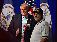 Ashburn, VA - August 2, 2016: Republican presidential candidate and businessman Donald J. Trump poses with Lt. Col. Louis Dorman (ret) during a campaign event in Ashburn, VA, August 2, 2016. Dorfman gifted his Purple Heart medal to Trump. (Photo by Don Baxter/Media Images International)