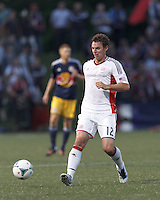 New England Revolution midfielder Andy Dorman (12) passes the ball.  2013 Lamar Hunt U.S Open Cup fourth round, New England Revolution (white) defeated New York Red Bulls (blue/yellow), 4-2, at Harvard University's Soldiers Field Soccer Stadium on June 12, 2013.