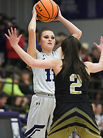 Elkins Ashley Brink (11) passes, Friday, February 14, 2020 during a basketball game at Elkins High School in Elkins. Check out nwaonline.com/prepbball/ for today's photo gallery.<br /> (NWA Democrat-Gazette/Charlie Kaijo)