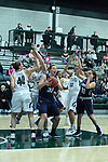 23 February 2018:  Mikaela Eppard grabs the ball for possession of a loose ball during an NCAA women's CCIW Semi-Final basketball game between the Elmhurst Bluejays and the Illinois Wesleyan Titans in Shirk Center, Bloomington IL
