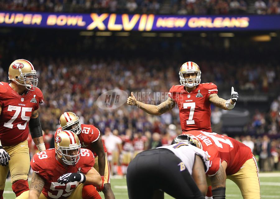 Feb 3, 2013; New Orleans, LA, USA; San Francisco 49ers quarterback Colin Kaepernick (7) calls a play against the Baltimore Ravens in Super Bowl XLVII at the Mercedes-Benz Superdome. Mandatory Credit: Mark J. Rebilas-