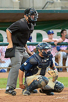 Michael Turay (15) of the Helena Brewers and home plate umpire Tyler Ferguson behind the plate in action against the Ogden Raptors at Lindquist Field in Ogden Utah on July 20, 2013.  (Stephen Smith/Four Seam Images)