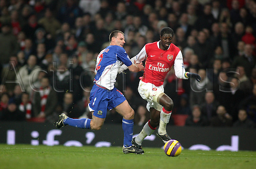 11 February 2008: Arsenal striker Emmanuel Adebayor competes with Andre Ooijer for the ball during the Premier League game between Arsenal and Blackburn Rovers, played at The Emirates Stadium. Arsenal won the game 2-0. Photo: Actionplus....080211 football soccer player premiership