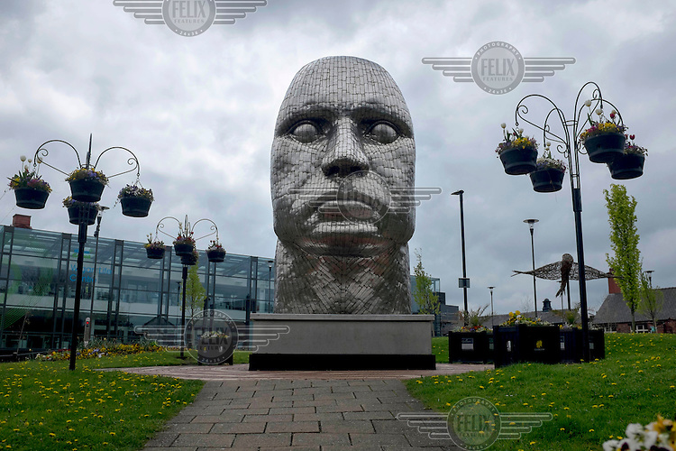 'The face of Wigan', a stainless steel sculpture by artist Rick Kirby in the town centre. /Felix Features