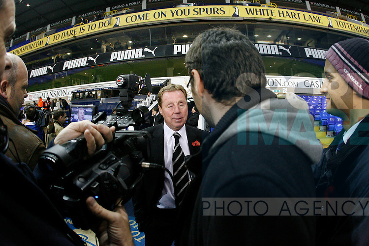 Tottenham's Harry Redknapp gets interviewed after the match