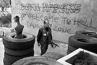 A Bosnian Army soldier walks past a mannequin used to try and draw fire from Bosnian Serb Army positions in Sarajevo on June 10, 1992.