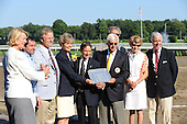 Newly inducted Hall of Fame members present the trophy for the Hall of Fame Stakes.