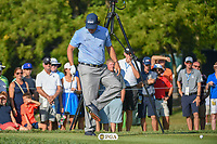 Phil Mickelson (USA) cleans mud from his shoes on 12 during 1st round of the 100th PGA Championship at Bellerive Country Cllub, St. Louis, Missouri. 8/9/2018.<br /> Picture: Golffile | Ken Murray<br /> <br /> All photo usage must carry mandatory copyright credit (© Golffile | Ken Murray)