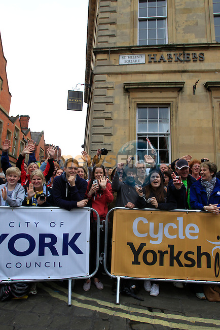 Massive crowds turn out as York hosts the start of Stage 2 of the 2014 Tour de France running 200km from York to Sheffield. 6th July 2014.<br /> Picture: Eoin Clarke www.newsfile.ie
