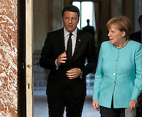 Il presidente del Consiglio Matteo Renzi, sinistra, e il cancelliere tedesco Angela Merkel a Palazzo Chigi, Roma, 5 maggio 2016.<br /> Italian Premier Matteo Renzi, left, and German Chancellor Angela Merkel arrive to attend a joint press conference following their talks at Chigi Palace, Rome, 5 May 2016.<br /> UPDATE IMAGES PRESS/Isabella Bonotto