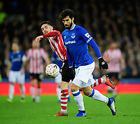 Lincoln City's Tom Pett vies for possession with Everton's Andre Gomes<br /> <br /> Photographer Chris Vaughan/CameraSport<br /> <br /> Emirates FA Cup Third Round - Everton v Lincoln City - Saturday 5th January 2019 - Goodison Park - Liverpool<br />  <br /> World Copyright &copy; 2019 CameraSport. All rights reserved. 43 Linden Ave. Countesthorpe. Leicester. England. LE8 5PG - Tel: +44 (0) 116 277 4147 - admin@camerasport.com - www.camerasport.com
