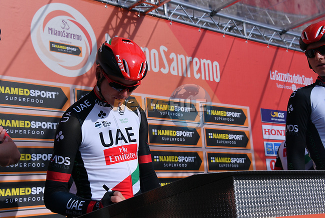 UAE Team Emirates rider at sign on before the start of the 108th edition of Milan-San Remo 2017 by NamedSport the first Classic Monument of the season running 291km from Milan to San Remo, Italy. 18th March 2017.<br /> Picture: La Presse/Gian Mattia D'Alberto   Cyclefile<br /> <br /> <br /> All photos usage must carry mandatory copyright credit (&copy; Cyclefile   La Presse)