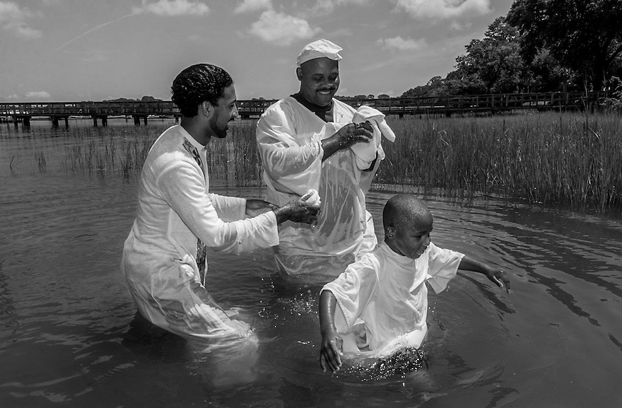 A young member of Mt. Calvary Missionary Baptist Church walks toward the shore after being baptized in Skull Creek. Mt. Calvary Missionary Baptist Church is one of the few churches on Hilton Head Island that still performs traditional river baptisms. Other churches have given up the practice as development has limited their access to the island's waterways.