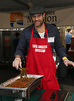 21 December 2018 - Los Angeles, California - Geoff Stults. Los Angeles Mission Christmas Meal for the Homeless held at Los Angeles Mission. Photo Credit: F. Sadou/AdMedia