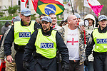 © Joel Goodman - 07973 332324 - all rights reserved . 11/11/2010 . London , UK . EDL Counter Demonstration . Muslims Against Crusades hold a demonstration and burn a poppy on the anniversary of Armistice Day , at Kensington Gore , opposed by a demonstration of nationalist groups including the English Defence League ( EDL ) . Photo credit : Joel Goodman