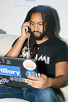Dave Pringle, 28, of Miami, is a law student volunteering with the Voter Protection phonebanking team at the campaign office of Democratic presidential nominee Hillary Clinton in the Wynwood Arts District of Miami, Florida. The team is working to recruit volunteers to watch the polls on election day. Pringle said he supported Bernie Sanders during the primary but switched to support Hillary after the New York primary vote earlier this year.
