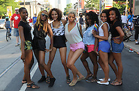Beautiful women posing for a group portrait during Toronto's 2010 Pride celebrations, a signaure event in a city rich with culture.