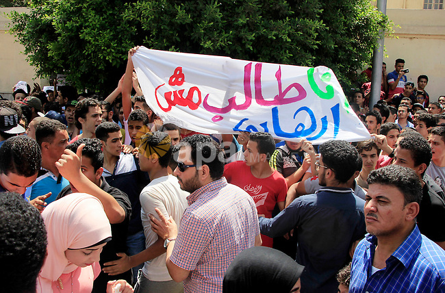 Egyptian students take part during a protest against cancelled a high school final exam in front of education ministry, in Cairo, Egypt, on June 27, 2016. Egypt cancelled a high school final exam yesterday after papers for it were leaked online, the education ministry said, in the latest such incident this month. Photo by Amr Sayed