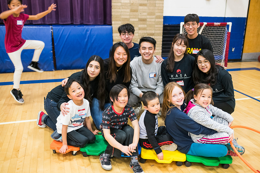Volunteers from UW-Madison's Korean American Student Association (KASA) enjoy playing with children during a lunar new year event hosted by Families Through Korean Adoption (FTKA) in the gym and school cafeteria of St. Dennis Church in Madison, Wis., on Feb. 10, 2018. The event celebrated the passing of the lunar new year, and is one of several events for FTKA-member families and children to gather and enjoy cultural fun, food and play. (Photo by Jeff Miller - www.jeffmillerphotography.com)