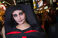 People dressed in nun costumes for Halloween in Shibuya, Tokyo, Japan. Friday October 31st 2014