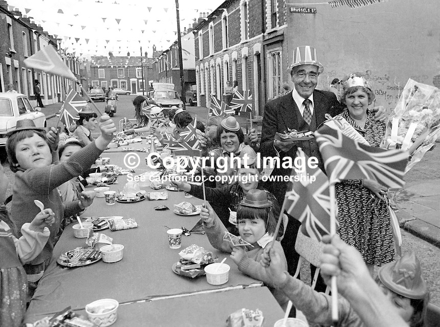 Shankill Road, Belfast, residents celebrate the Silver Jubilee of Queen Elizabeth II with a party in Matchett Street.  With John McQuade, aka Johnny McQuade, who was the local MP until the N Ireland Parliament was abolished in 1973 is pictured with the Shankill Jubilee Queen, name not known, can you help?  Taken: 7th June 1977. 197706070089g<br />