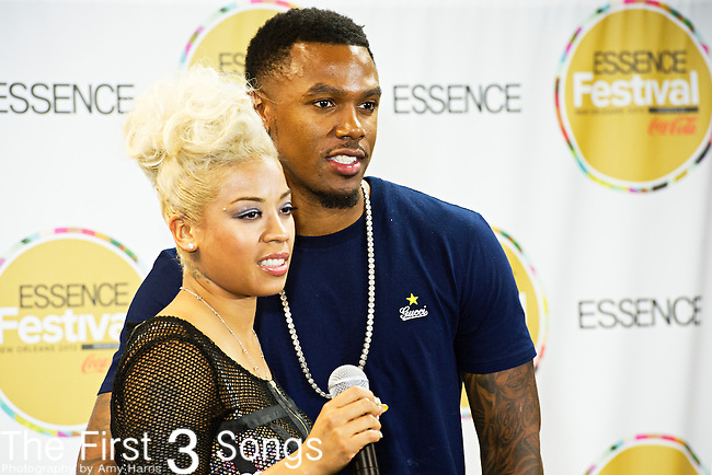 Keyshia Cole and husband Daniel Gibson pose for the press at the 2013 Essence Festival at the Mercedes-Benz Superdome in New Orleans, Louisiana.