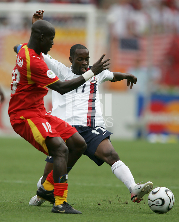 U.S. midfielder (17) DaMarcus Beasley pushes the ball away from Ghananian midfielder (10) Stephen Appiah. Ghana defeated the USA 2-1 in their FIFA World Cup Group E match at Franken-Stadion, Nuremberg, Germany, June 22, 2006. Ghana advances to round of 16 and the USA is out of the tournament.
