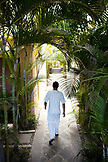 MAURITIUS, Chemin Grenier, South Coast, a massage therapist on his way to treat a guest at the spa, Hotel Shanti Maurice